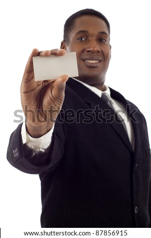 Young African American businessman holding a white business card - stock photo