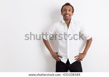 Young african american businessman on white background with copy space - stock photo