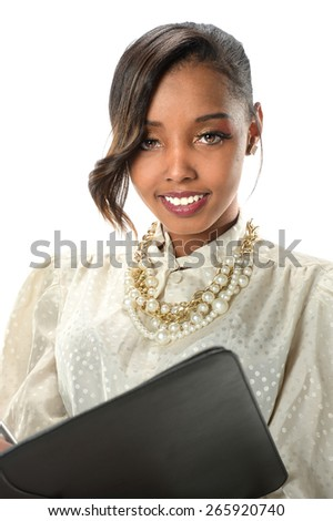 Young African American businesswoman holding folder - stock photo