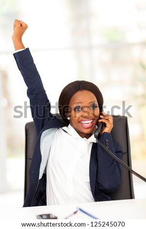 young african american businesswoman receiving exciting news - stock photo