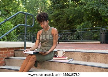 Young african american college student studying on campus
