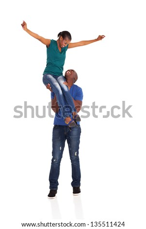 young african american couple having fun on white background - stock photo