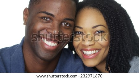 Young African American couple smiling together - stock photo