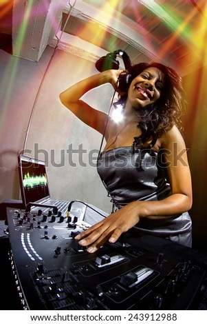 young african american female dj playing music at a party