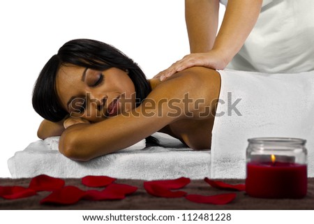 young African American female getting a massage - stock photo