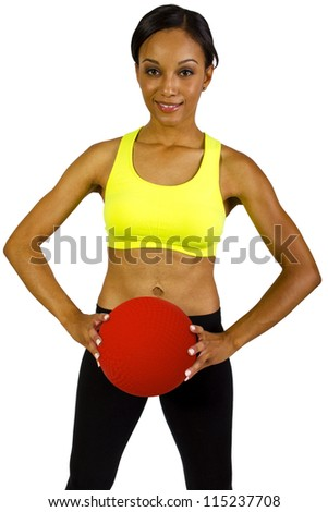 young African American Female holding a dodge ball - stock photo