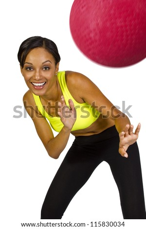 young African American female playing dodgeball - stock photo