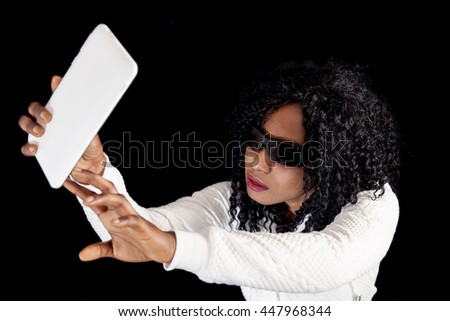 young african american girl in white sweater takes a selfie - stock photo
