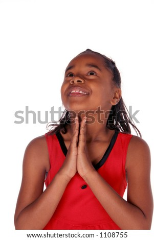 young African American looking up as she prays - stock photo