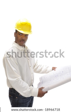 young African American man in a hardhat with house plans - stock photo