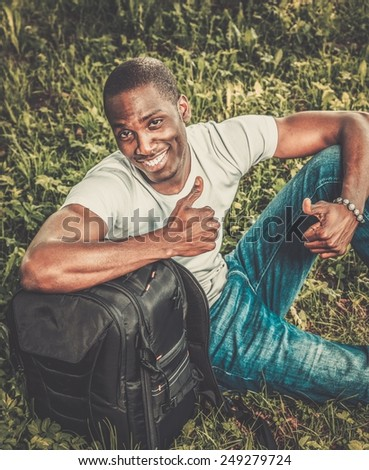 Young african american man in a park - stock photo