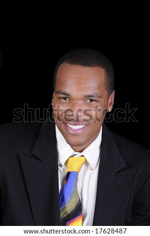 young African American man in a suit - stock photo