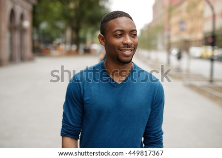 Young African American man in city smile happy face walking