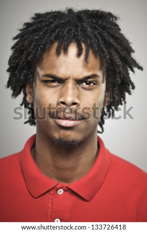 Young African American Man With Doubtful Expression - stock photo