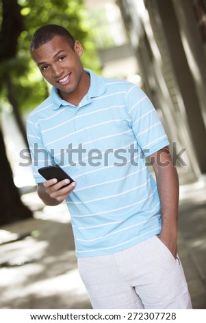 Young african american man with mobile phone - stock photo