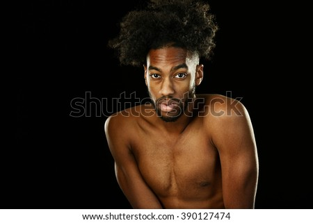 Young African American man with nude  - stock photo
