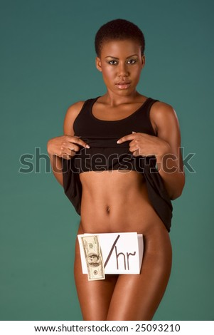 Young African American model pose as black prostitute offering sexual services for money. She pull up dress and we see no underwear, her genitals is covered by paper with $100 US dollar bill attached - stock photo
