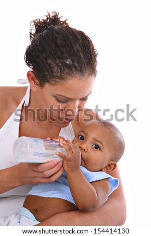 Young African American Mother Feeding Baby Boy with Milk Bottle - stock photo