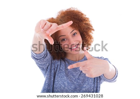 Young african american  photographer making frame gesture with the hands, isolated on white background - stock photo
