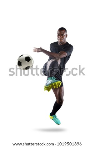 Young African American soccer player kicking ball isolated over white background