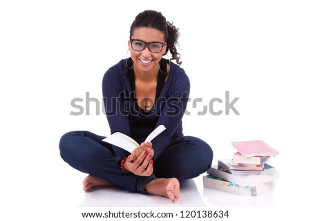 Young African American student girl reading a book, isolated on white background