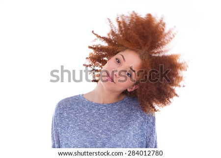 Young african american  teenage girl playing with her curly hair isolated on white background - stock photo