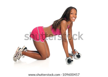 Young African American woman exercising with dumbbells on floor isolated over white background
