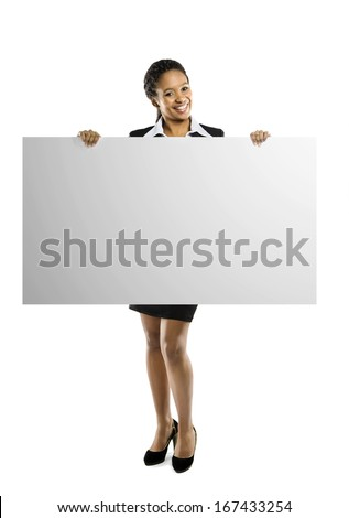 Young African American woman holding blank sign isolated on a white background - stock photo