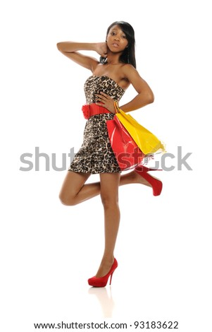 Young African American Woman holding shopping bags isolated on a white background - stock photo