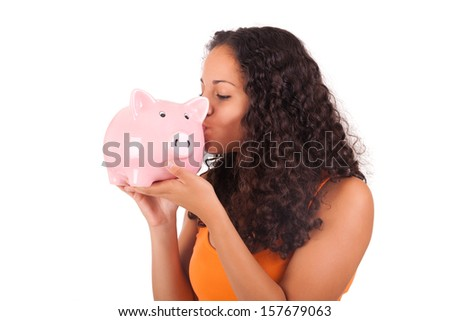Young african american woman kissing piggy bank isolated