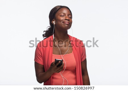 Young African American woman listening to iPod, horizontal