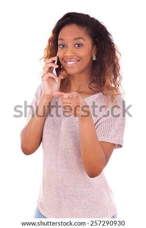 Young African American woman making a phone call on her smartphone - Black teenager people - stock photo