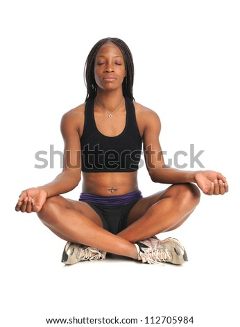 Young African American woman meditating sitting isolated over white background - stock photo