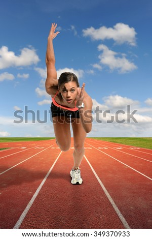 Young African American woman running on track