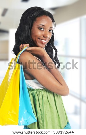 Young African American woman shopping inside a mall - stock photo