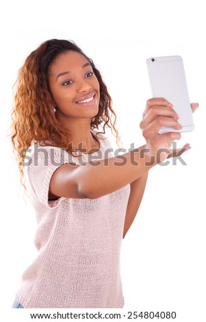 Young African American woman taking a selfie - self portrait - Black teenager people - stock photo