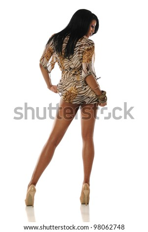 Young African American Woman wearing a beige dress and high heels - stock photo