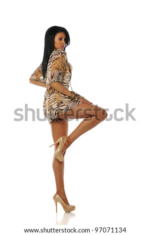 Young African American Woman wearing a dress and high heels on a white background - stock photo