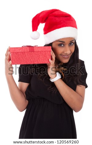 Young African American woman wearing a santa hat holding gift box, isolated on white background - stock photo