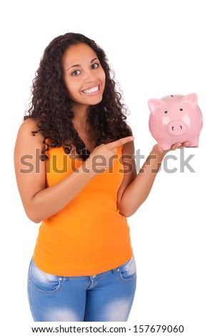 Young african american woman with piggy bank isolated - stock photo