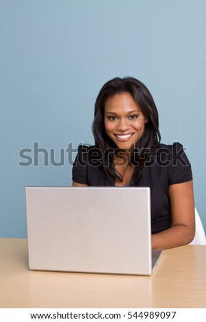 Young African American woman working on the computer.