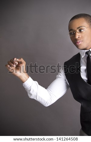 Young African American writing with a pen - stock photo