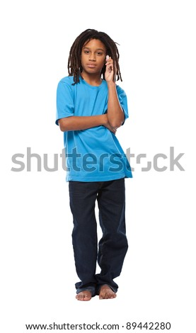 young african boy posing with cellphone isolated on white - stock photo