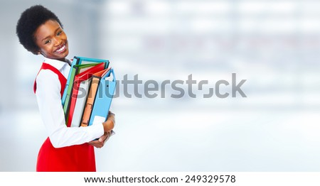 Young african business woman over blue background - stock photo