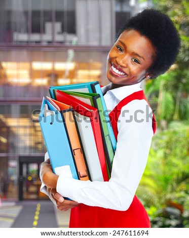 Young african business woman over college background - stock photo