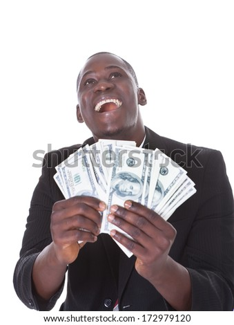 Young African Businessman Holding Banknote Looking Up - stock photo