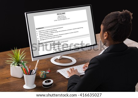 Cv resume stock images royalty free images vectors shutterstock young african businesswoman analyzing resume on computer in office sciox Image collections