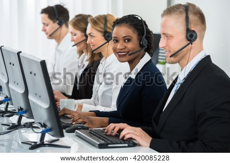 Young African Businesswoman With Headset Working With Other Colleagues In Call Center