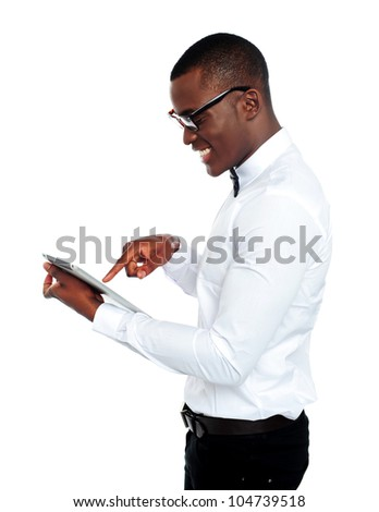 Young african geek using electronic device. Touch screen technology - stock photo