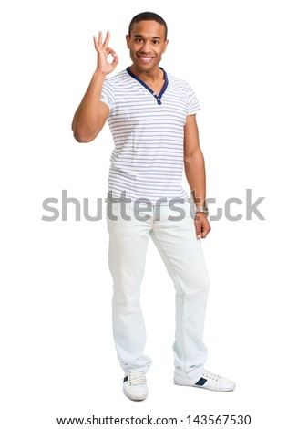 Young African Gesturing Ok Sign Over White Background